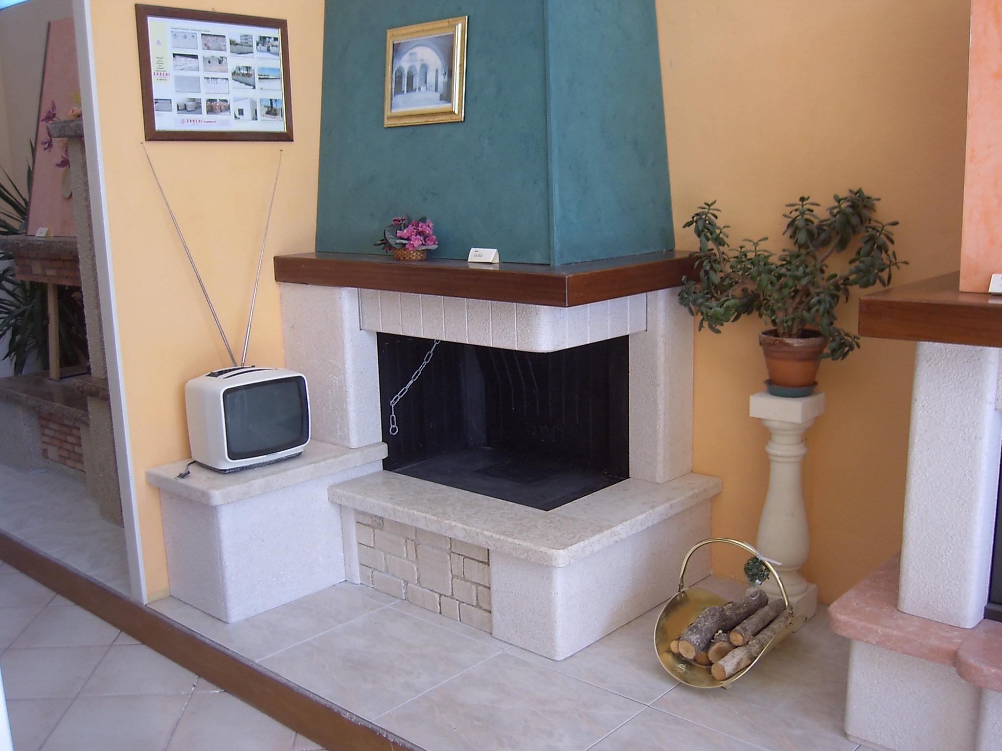 Errebi marmi lavorazione marmi graniti pietre for Piani casa con camino nel centro della casa